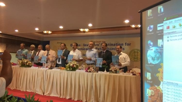 Honble Minister Industries unveiling the souvenir book ...
