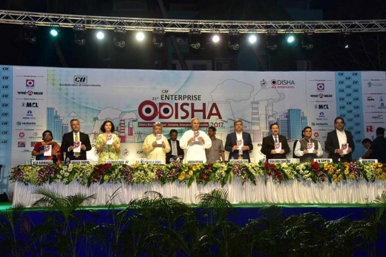 Honble Chief Minister, Shri Naveen Patnaik, is unveiling the new Investors Guide during the Enterprise Odisha 2017